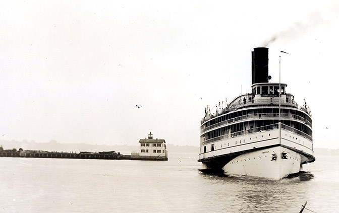 SS Commonwealth passing the Newport Harbor Light